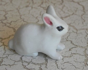 white porcelain baby bunny rabbit crouching