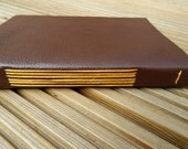 Leather Art Journal in Dark Walnut Brown. Coloured Mulberry paper lining and coloured linen binding.  Custom Order for Caitlin