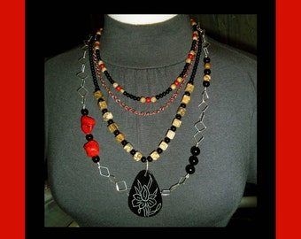 Four necklace set with strands of jasper, sterling silver chain, turquoise, onyx, leather and pen shell pendant with etched flower