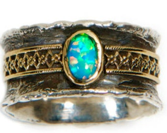 Silver Ring. Statement ring / Sterling SILVER and 9 ct gold set   Garnet / Blue topaz / Opal / Tourmaline.