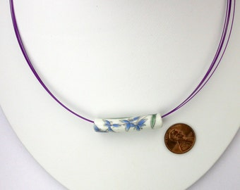Ceramic Flower Bead on Purple Wire