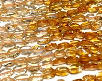 Citrine gemstone flat ovals full 14 inch strand Premium quality stones shaded color