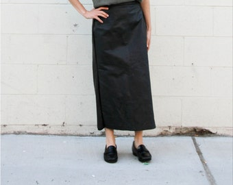 Black full length leather skirt. S/M
