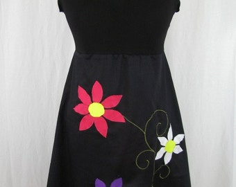 Kyriu black dress and colorful flowers