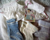 Vintage baby items, baby dress with hanger, vintage knit booties, baby button card, vintage button card, pearl buttons, cute nursery display
