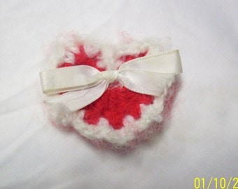 crochet red heart with white trim and white satin ribbon pin great for Valentine's Day