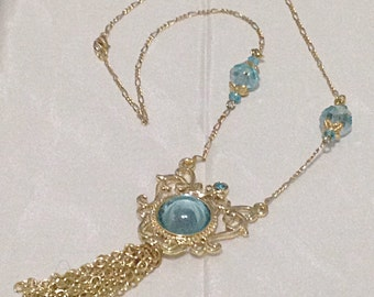 Gold Filigree necklace with light blue stones