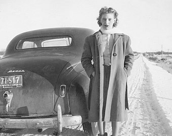 Vintage Photo Woman with Car in Snow on Winter Road 1940s or 1930s Fashion Snapshot.