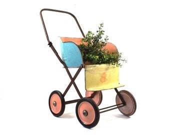 vintage 40s 50s tin stroller baby shower prop present display centerpiece party supplies decorative home decor antique toy doll pastel metal