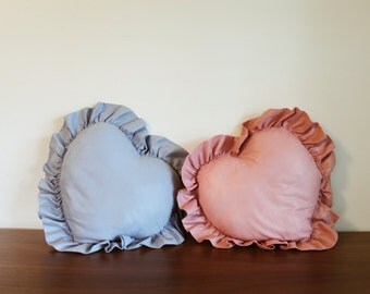 two vintage heart shaped pillows