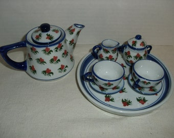 Tiny Doll Tea Set.  Plate with Two Cups and Saucers, Teapot, Sugar and Creamer.