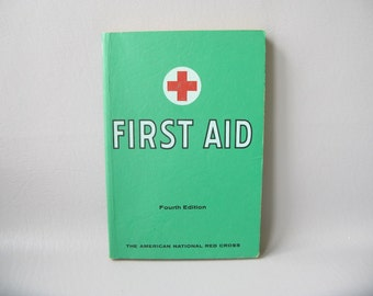 First Aid Book. High School Text, Paperback, red cross