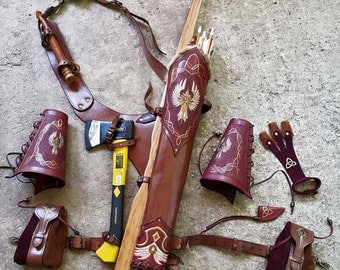 A Multi-functional Quiver With Two Arm Guards And Two Belt Pouches