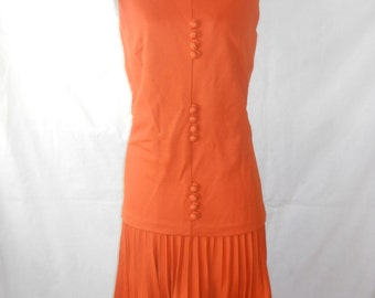 vintage 1960s orange dress w/ pleated skirt detail