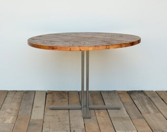 Round pedestal dining table in reclaimed wood and steel legs in your choice of color, size and finish