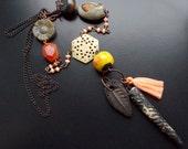 Dark Star Tribal Necklace with Pink silk tassel, ceramic charms, artisan beads, butterfly bead, carved bone star, carved adventurine flower