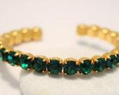 Vintage green crystal bangle.  Rhinestone bangle.