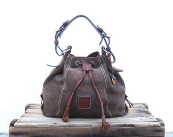 15% Off Out Of Town SALE Dooney and Bourke Olive Suede Drawstring Bucket Bag