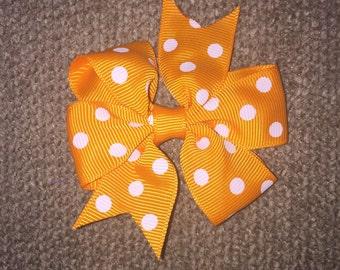 Orange pinwheel polkadot pig tail hair bows (set of 2)
