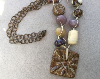 Flower Burst Button Pendant with Ceramic, Lampwork Glass, and Lepidolite on Linen Thread and Bronze Chain
