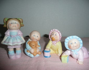 FOUR Adorable Cabbage Patch Doll Porcelain Figurines
