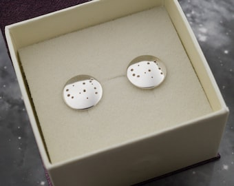Silver Gemini earrings: Sterling silver earrings showing the constellation of Gemini.