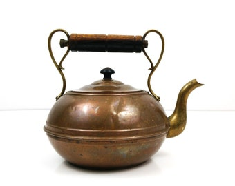 Vintage copper and brass tea kettle with wood handle