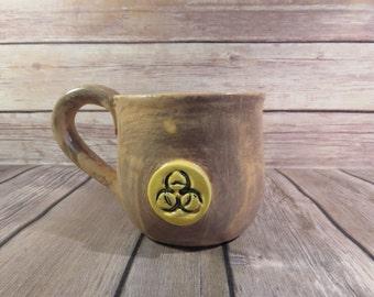 Brown and Yellow Biohazard mug