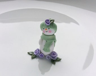 Christmas snowman ornament in pale green handmade from polymer clay