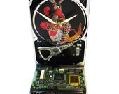 "Hard Drive Clock with Computer Parts ""Kangaroo"" Dial. Print Model used 1960s Computer Parts."
