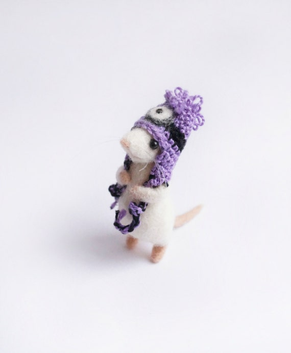 Needle felted mouse wearing purple minion hat