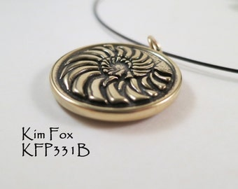 Round reversible Nautilus and Scallop Pendant in Bronze designed by Kim Fox