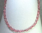 Delightful pink necklace with glittering stars