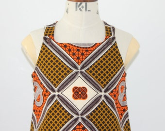 African Print girl's pinafore dress in a brown and orange paisley print