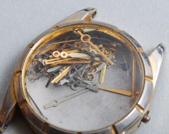 Treasure Chest, Lot of Vintage watch hands in vintage man watch case