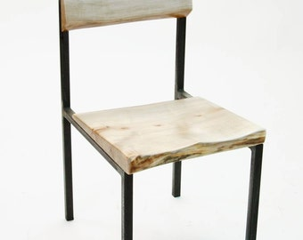 Plum Chair in live-edge Silverleaf maple and waxed steel.