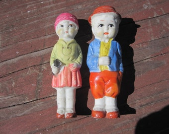 Two Bisque Frozen Charlotte Penny Boy and Girl dolls