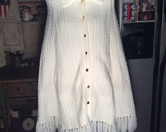 One Size Fits Most white acrylic knitted cape with golden buttons.--fringed