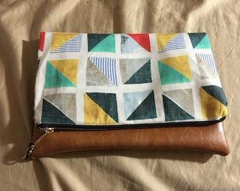 Fold over clutch. No snap. Inside small pocket
