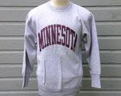 Late 80's, early 90's University of MN Champion beand reverse weave sweatshirt, fits like a medium