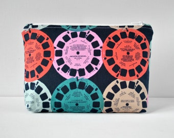 Padded woman's navy blue photo view master travel make up pouch cosmetics bag novelty print in blue and red.