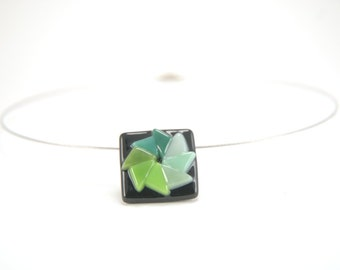 Color pinwheel in greens fused glass necklace, black and various shades of green