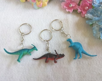 10 Dinosaur Key Holders Party favors or Cupcake toppers.