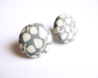 Fabric covered button earrings in grey and white, with leaf pattern