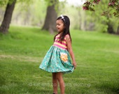 "Girls  ""flower garden""  dress .     Available girls 6 months to 12 years."