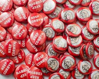 A pair of DoodleCorbyn badges