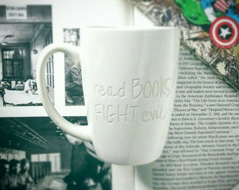 read BOOKS FIGHT evil Engraved Mug