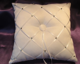 Let you Ring Bearer Sparkle with this white satin pillow accented with rhinestones and crossed ribbon.