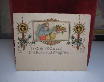 1920's-30's unused embossed gold gilded hand colored christmas card medieval servant with a boars head on a platter holly berry candles
