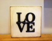 Aged Love Sign.  Wood sign.  Typography.